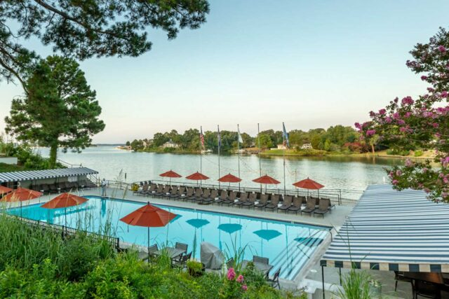 outdoor pool near body of water during daytime