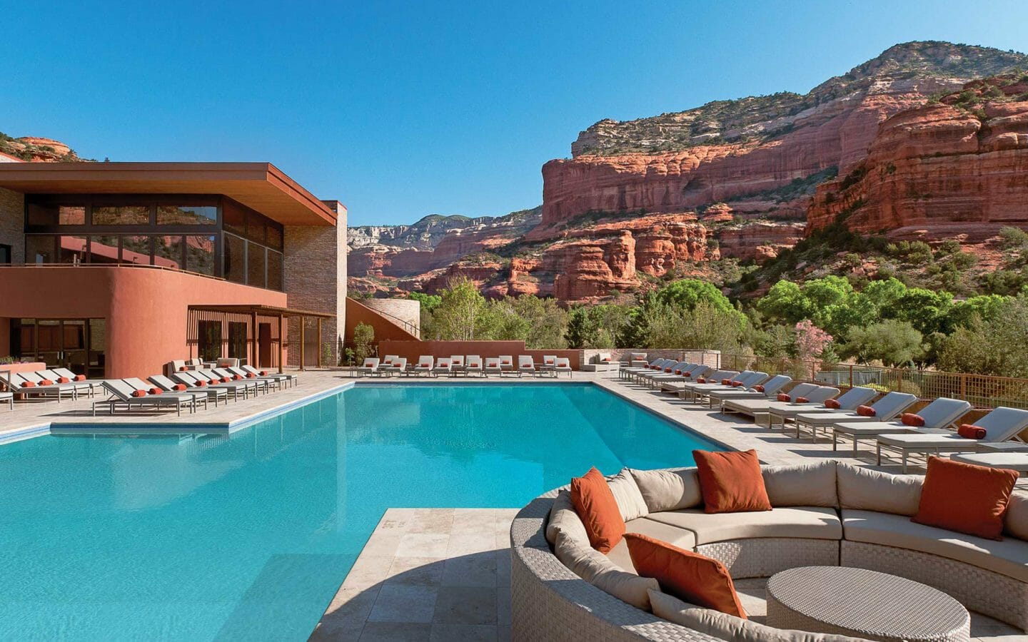 outdoor resort pool with lounger chairs