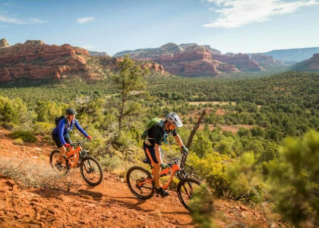 two men riding mountain bikes in sedona