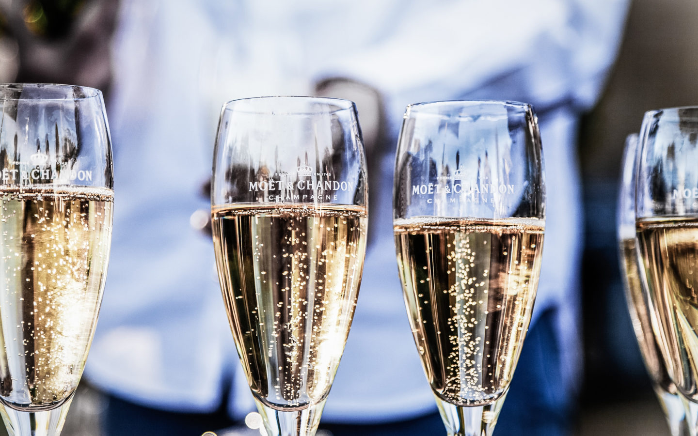 four glasses of champagnes