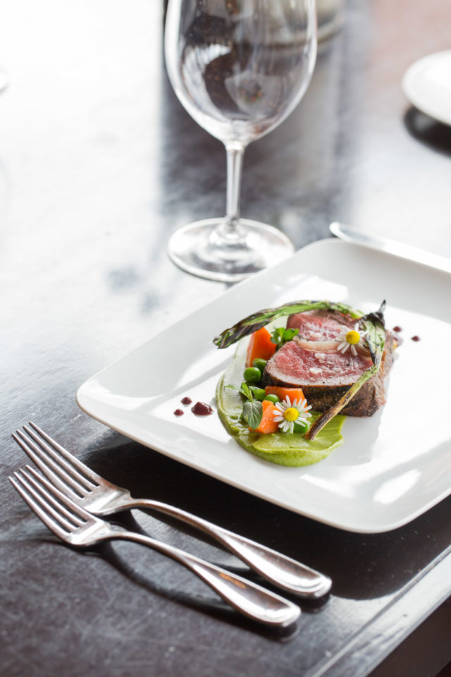 cooked meat and vegetables in square plate