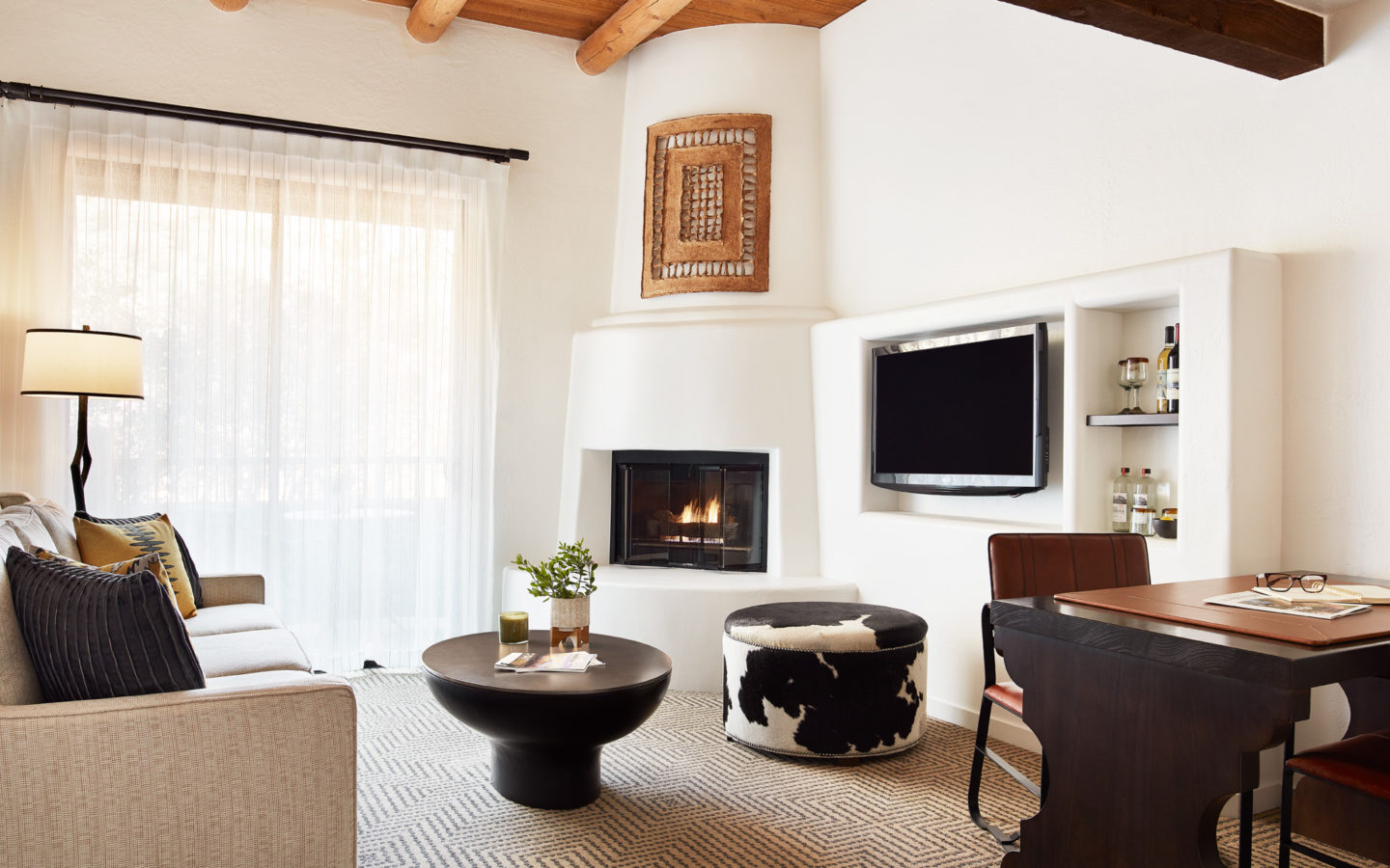 black and white fireplace near white window curtain