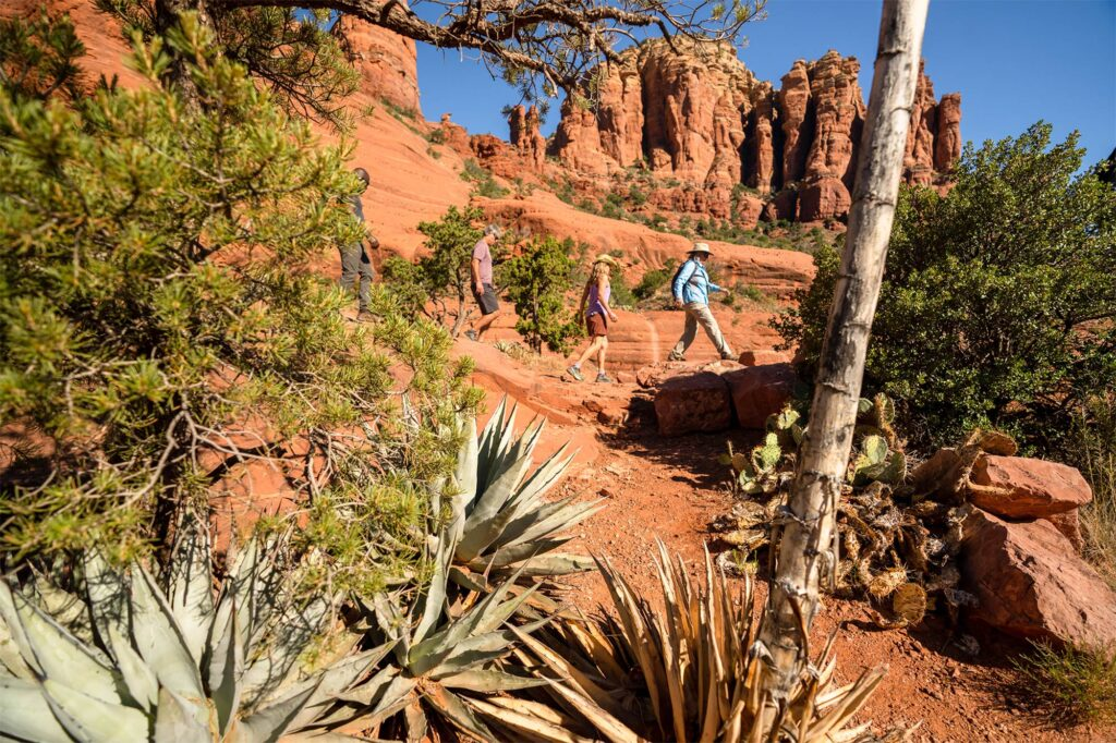 Two hikers in canyon with guide