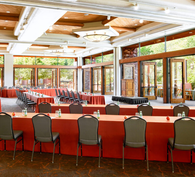 Large ballroom with long tables and chairs