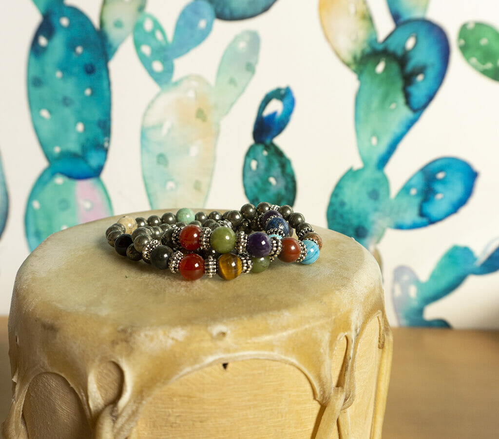 Bracelet made of beads sitting on a leather drum