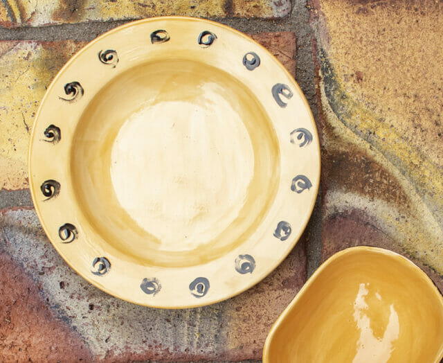 yellow and black pottery bowl