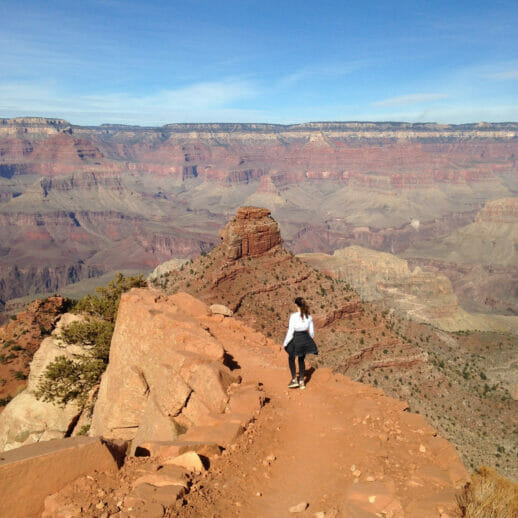 woman at the mountain top overlooking the Grand Canyon