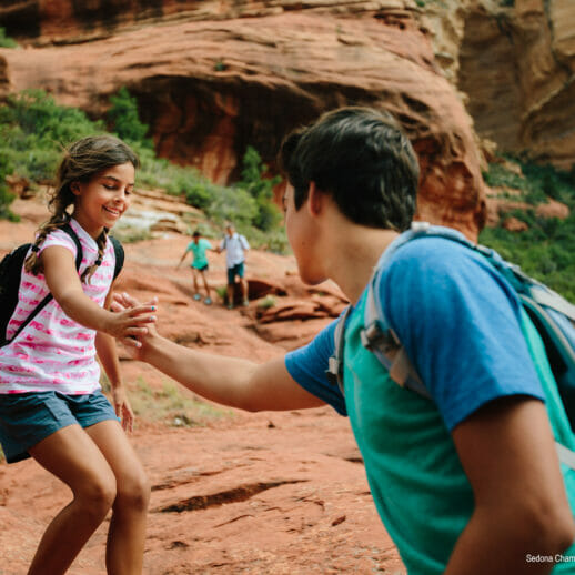 father assisting girl hike in Sedona
