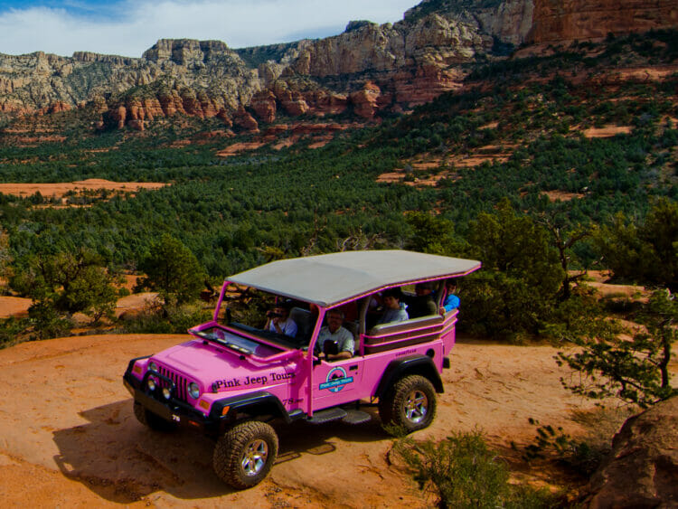 Pink Jeep on Red Rocks in Sedona