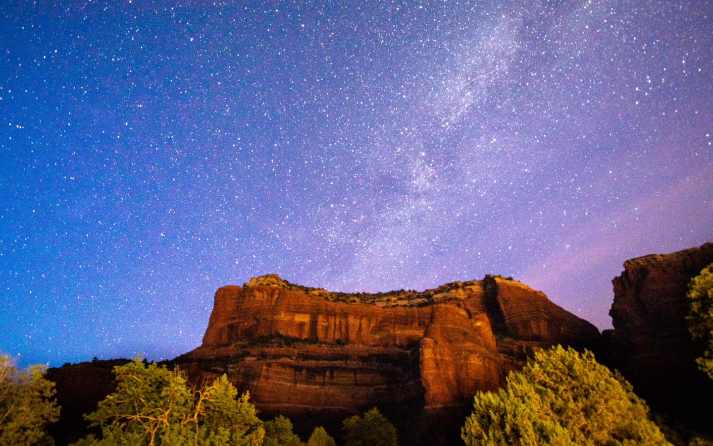 milky way on rock formations