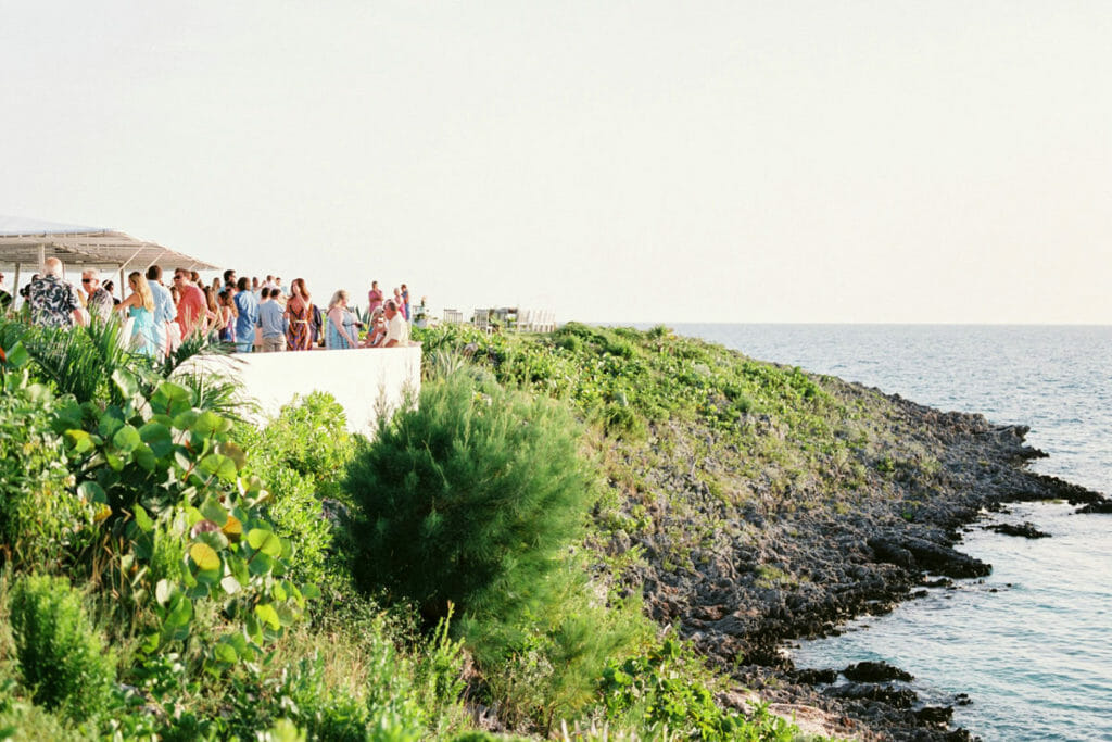 people gathering near outdoor beside seashore during daytime