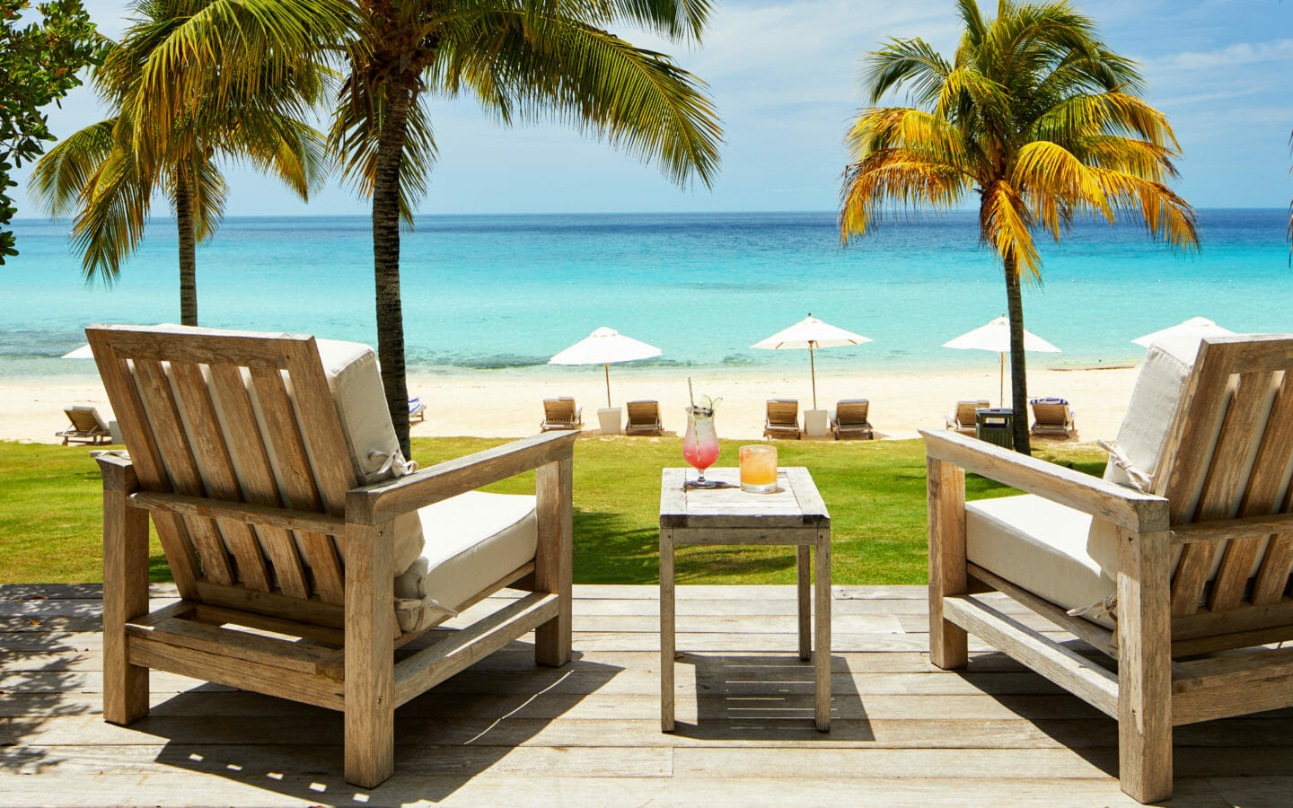 Chairs in front of Caribbean water | Cove Eleuthera