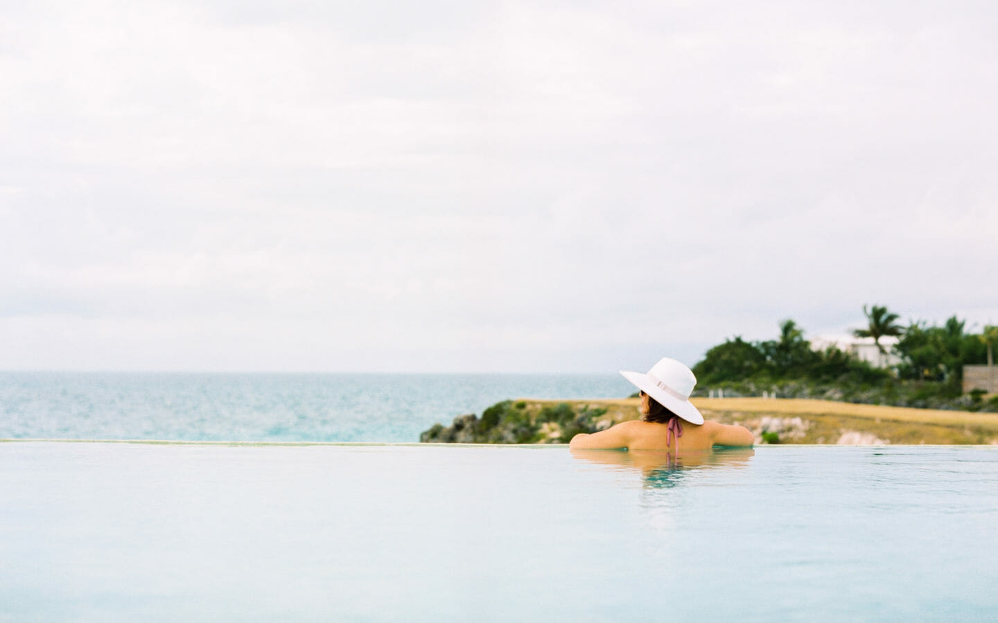 woman in infinity pool at Cove Eleuthera Resort Bahamas