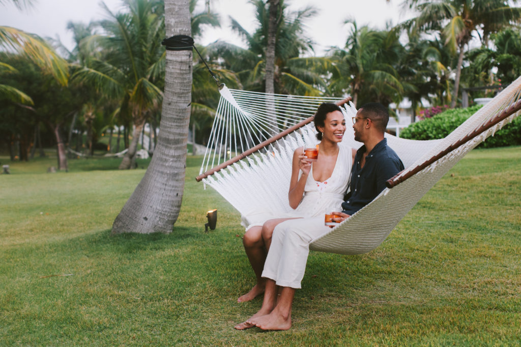 couple sitting on hammock during daytime