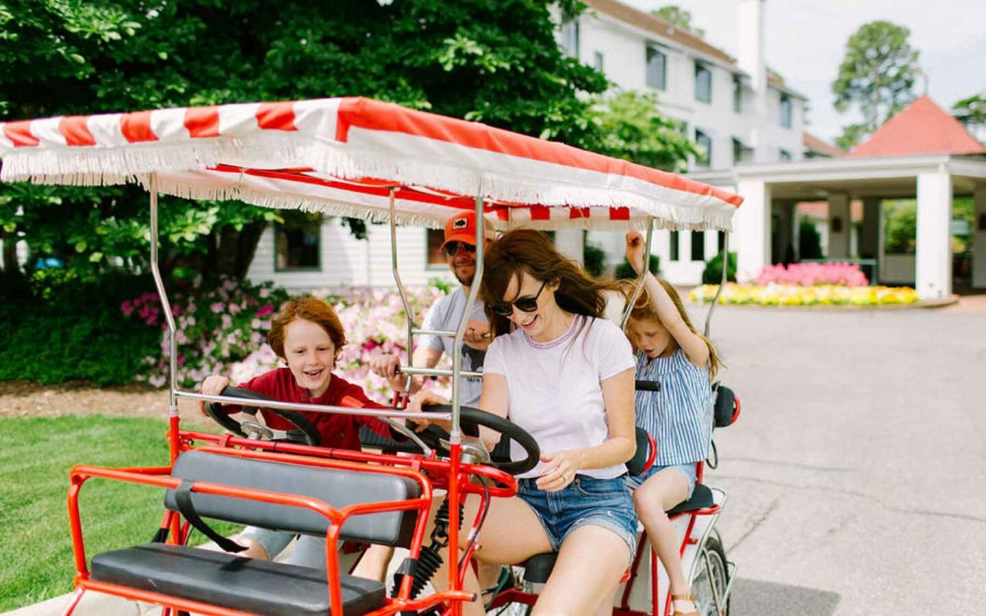 Family on a pedal car