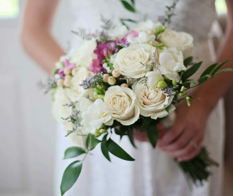 Bride holding flowers | Tides Inn