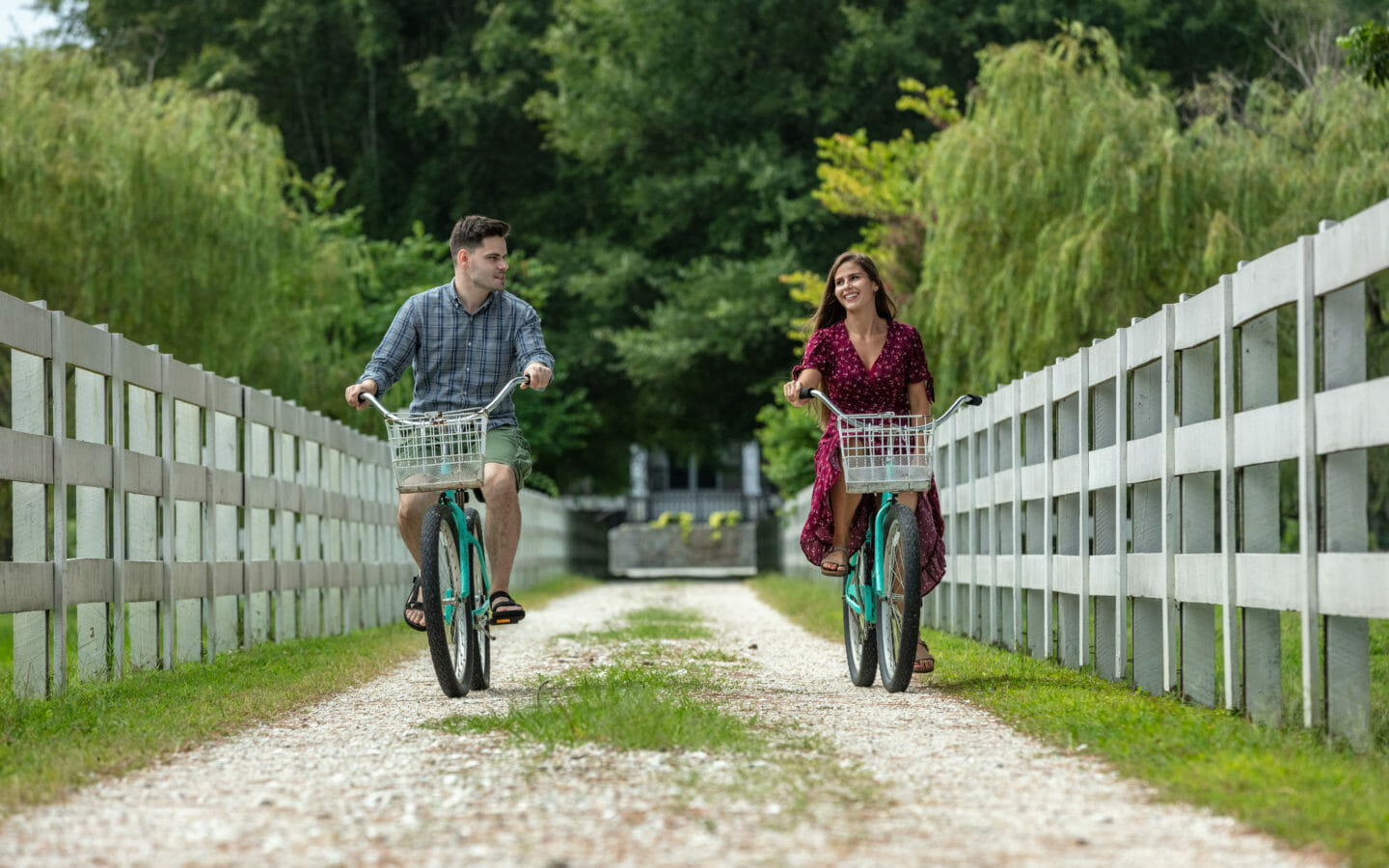 man and woman riding bicycle outdoor during daytime