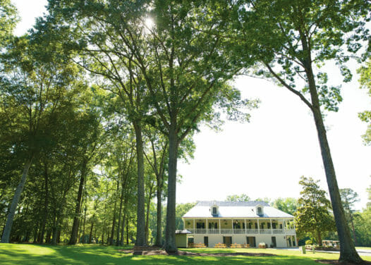 golf course clubhouse surrounded by trees during daytime