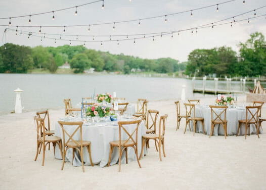 Tables and chairs near water setup for wedding reception