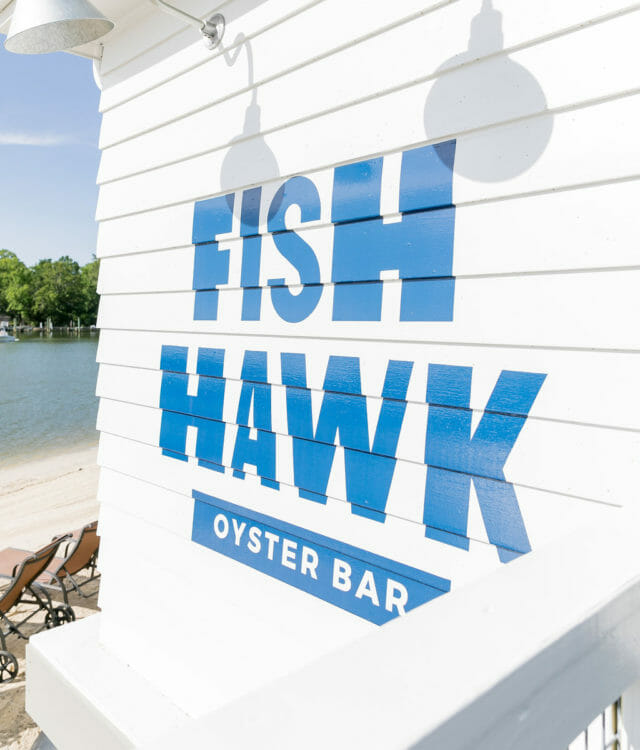 white and blue Fish Hawk Oyster Bar wall during daytime
