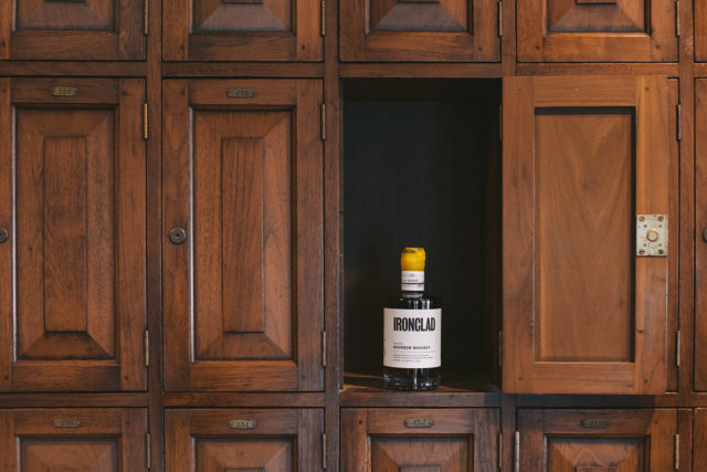 black and white labeled bottle on brown wooden cabinet