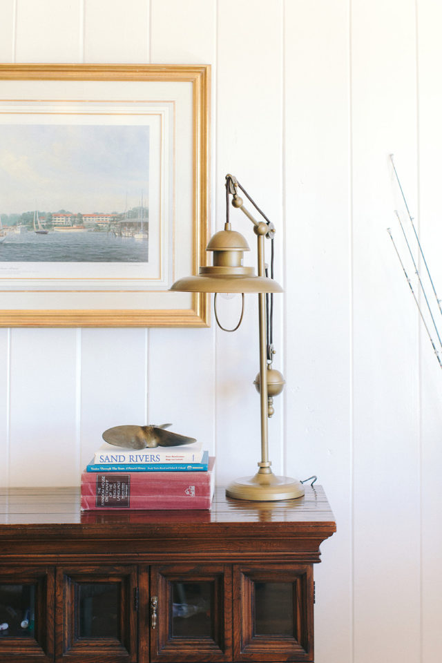 brass and silver table lamp on brown wooden table