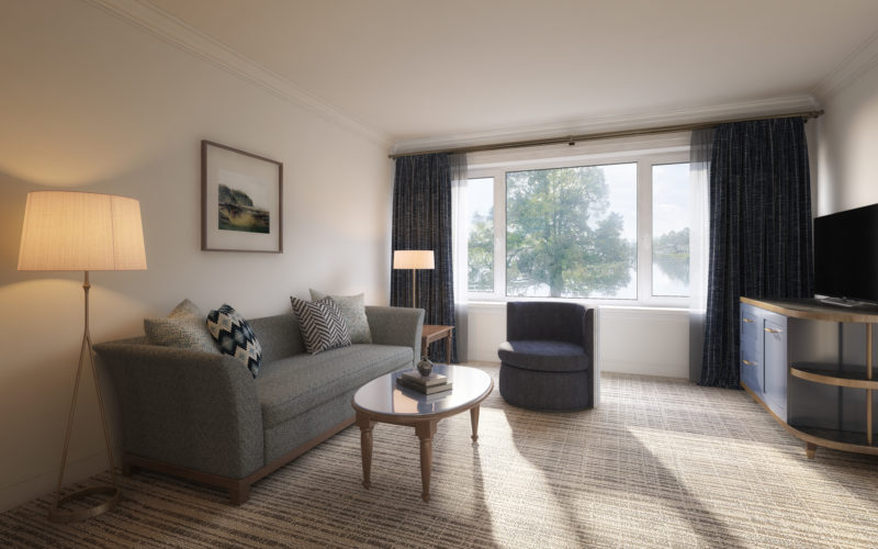 gray sofa chair near window