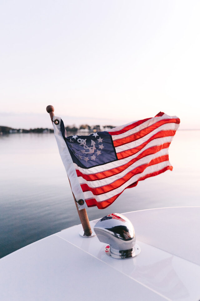 The United States Yacht Ensign flag on the front of a boat