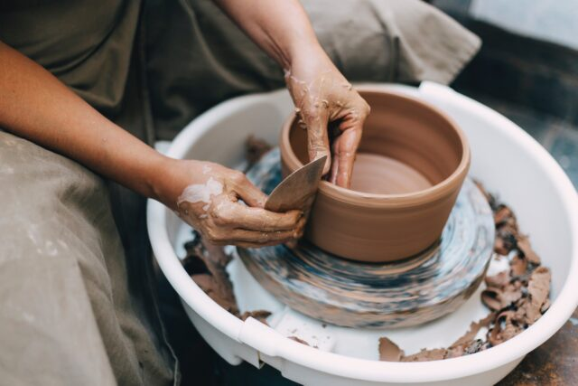 person using a pottery wheel