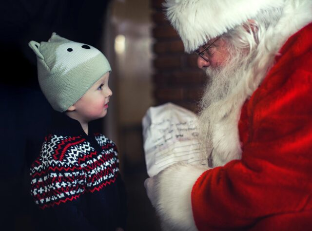 Santa Claus speaking to young child