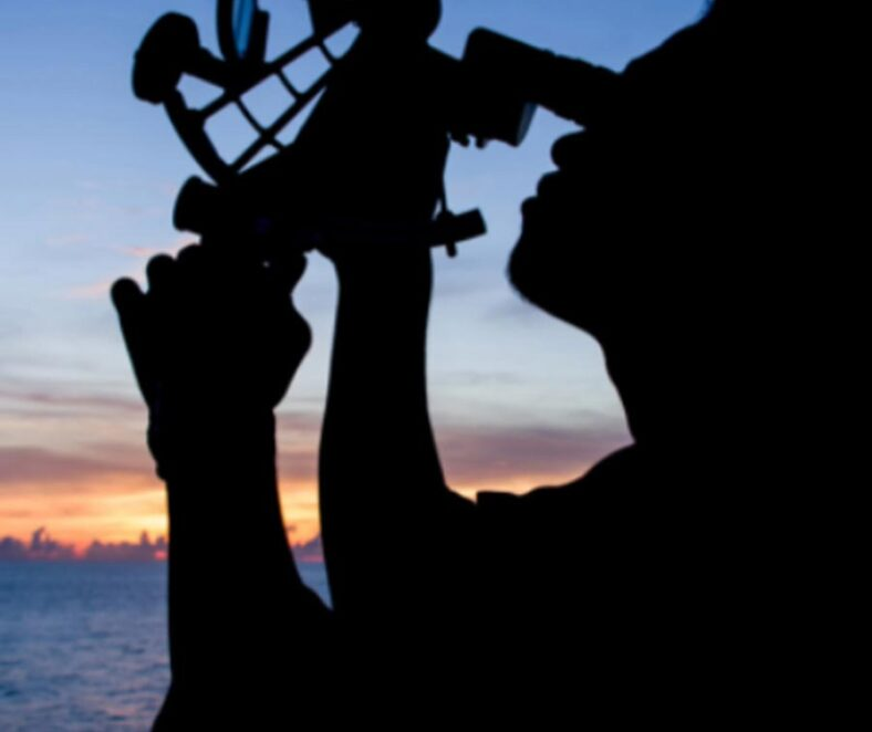 Silhouette of person using navigation instrument