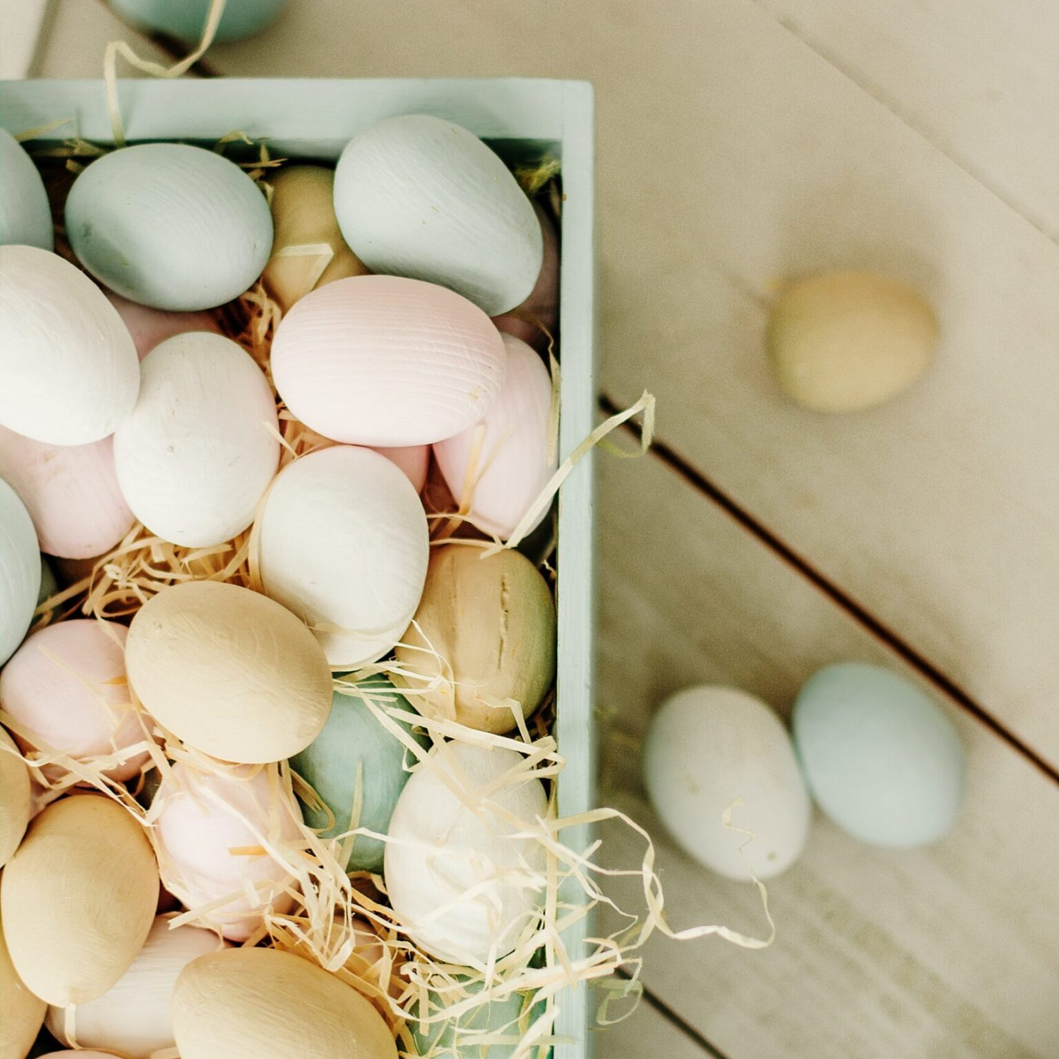 box of wooden easter eggs