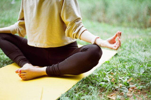 Woman in yoga position on a yoga mat
