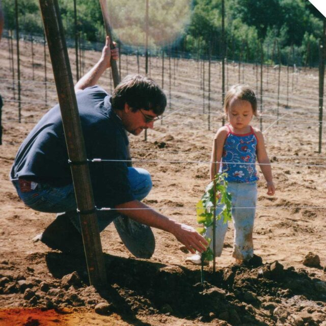 man and a child planting